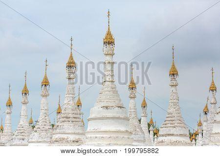 White stupas of Kuthodaw Pagoda with Tripitaka Stones Inscriptions inside in Mandalay, Myanmar