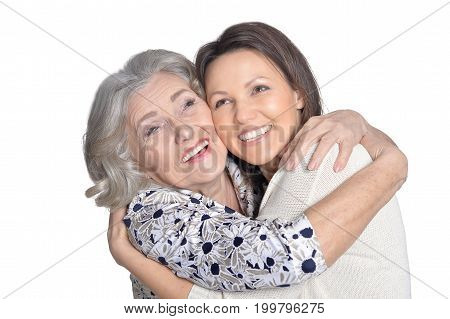 Senior woman screaming on her daughter isolated on white background