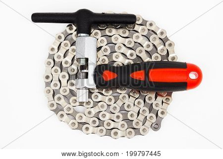 The bike chain tool and chain on the white background