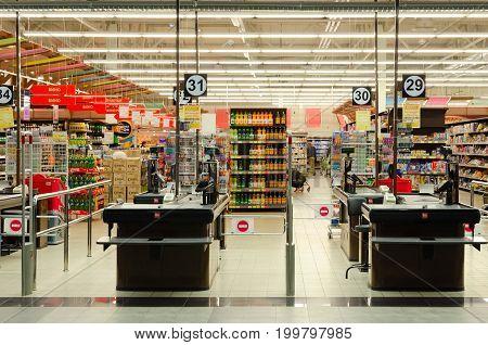 MOGILEV BELARUS - SEPTEMBER 27 2016: Unknown people visit large modern Euroopt store in shopping center of E-City along Gagarina Street Mogilev Belarus