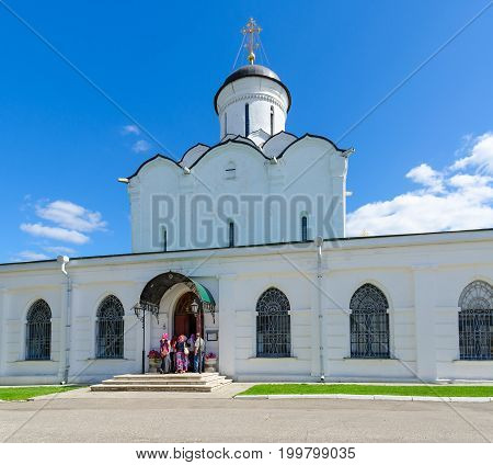 VLADIMIR RUSSIA - AUGUST 21 2015: Group of pilgrims enters Assumption Cathedral of Holy Dormition Knyaginin convent Vladimir Russia