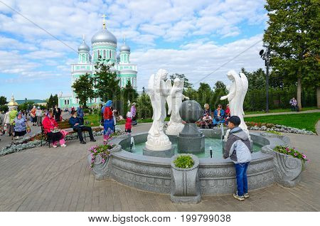 DIVEEVO RUSSIA - AUGUST 22 2015: Unknown pilgrims are on territory of famous Holy Trinity Seraphim-Diveevo Convent Diveevo Russia