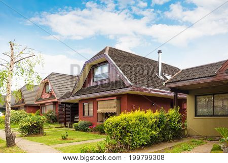 Typical chilean two-storey houses at summer in Valdivia