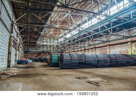 Warehouse with production twisted rubber tubing of industrial hoses