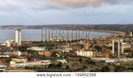 Editorial SWANSEA, UK - JUNE 4, 2017: A view taken from the East side SA1 area, the main approach into Swansea City, showing the bay, main town centre, leisure facilities and the Meridian Tower.