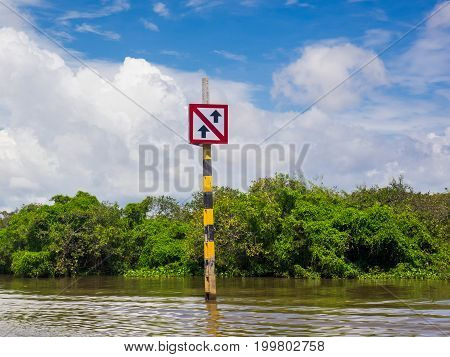 Boat traffic sign at Tonle Sap Lake, Siem Reap, Cambodia, caution about the traffic in community district
