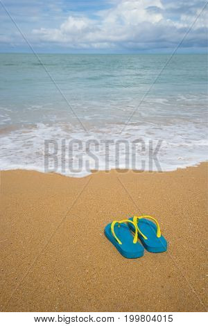 Flip flops on a sandy ocean beach, Beach sandals on the sandy coast