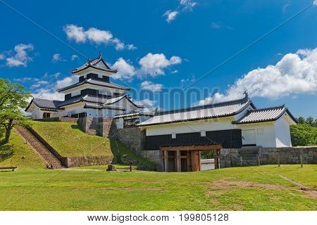 SHIRAKAWA JAPAN - JUNE 2 2017: Reconstructed Donjon and Main Gate of Shirakawa (Komine) Castle Japan. Castle was founded in 1340 rebuilt in 1627 destroyed in war of 1868 and reconstructed in 1991