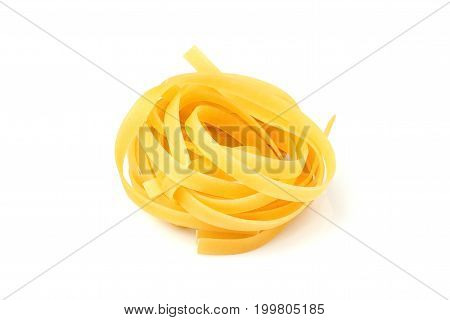 Pasta tagliatellefettuccine isolated on a white background.