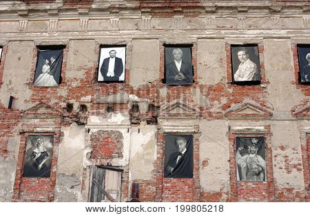 TULCHYN, UKRAINE - JUNE 05, 2017: Tulchyn castle is decorated with photographies of famous people during OperaFestTulchyn international opera open air festival that was held in Tulchyn on the territory of Potocki Palace, Vinnytsia region, Ukraine