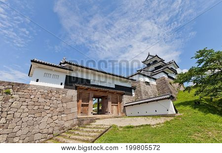 SHIRAKAWA, JAPAN - JUNE 2, 2017: Reconstructed Donjon and Main Gate of Shirakawa (Komine) Castle, Japan. Castle was founded in 1340, rebuilt in 1627, destroyed in war of 1868 and reconstructed in 1991