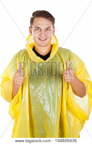 Picture of a young man wearing a yellow raincoat showing thumbs up on isolated background