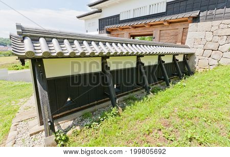 SHIRAKAWA JAPAN - JUNE 2 2017: Reconstructed wooden walls of Shirakawa (Komine) Castle Japan. Castle was founded in 1340 rebuilt in 1627 destroyed in war of 1868 and reconstructed in 1991