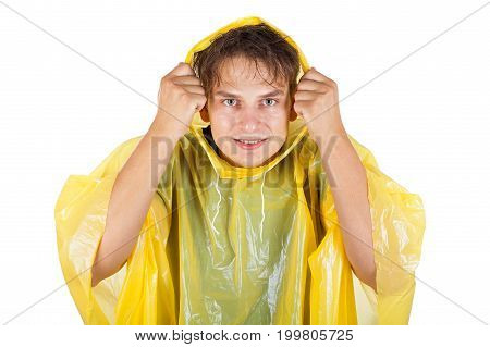 Picture of a caucasian young man wearing a yellow raincoat posing on isolated background