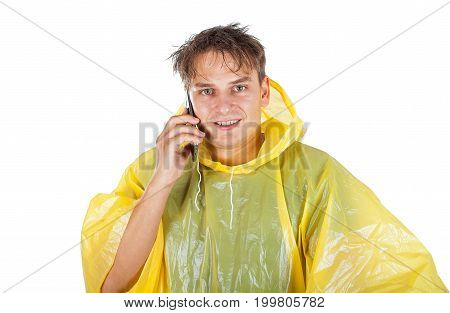 Picture of a young man wearing a yellow raincoat calling a taxi - posing on isolated background