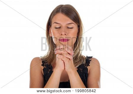 Picture of a religious young woman praying on isolated background