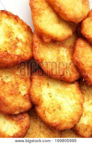 Tasty potato pancakes on white plate closeup