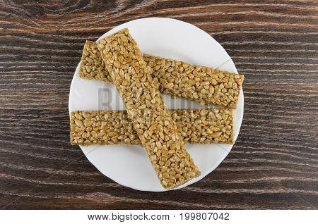 Pieces Of Kozinaki With Sunflower Seeds In White Plate