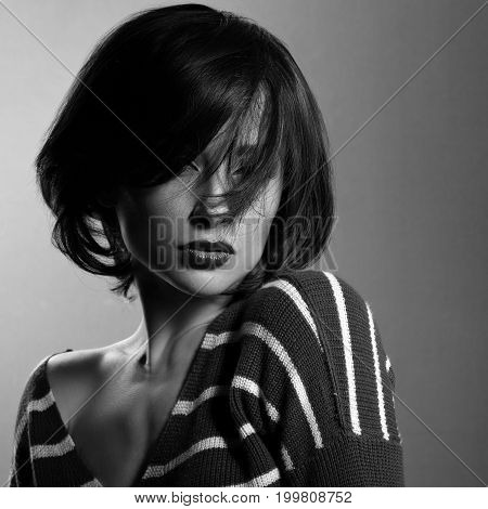 Beautiful Enjoing Woman Moving And Shaking Her Short Black Hair Style In Fashion Pullover. Black And