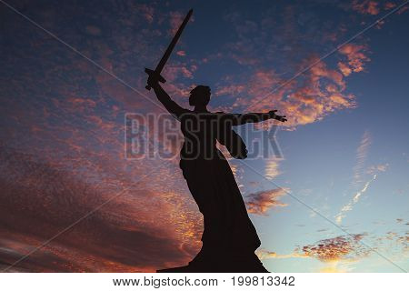 Monument of Motherland at red sunset sky in ex Stalingrad