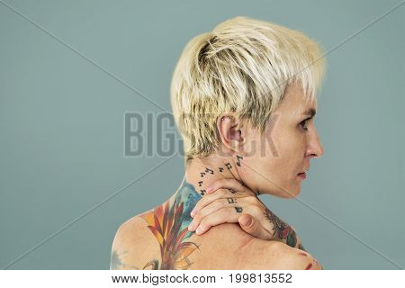 Caucasian shirtless with tattoo on her back side