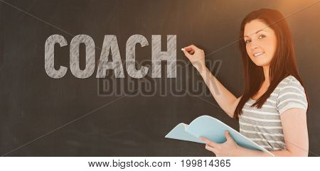 Word Coach against young woman about to write on a blackboard looking at the camera