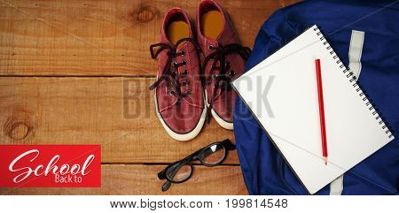 Back to school text over white background against schoolbag with apple and digital tablet on table