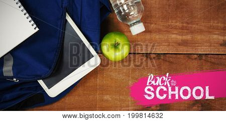 back to school against schoolbag with apple and digital tablet on table