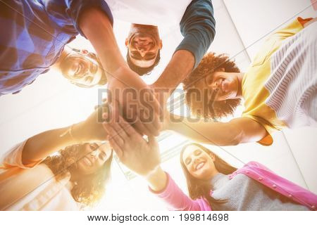 Low angle view of business executives forming hands stack at office