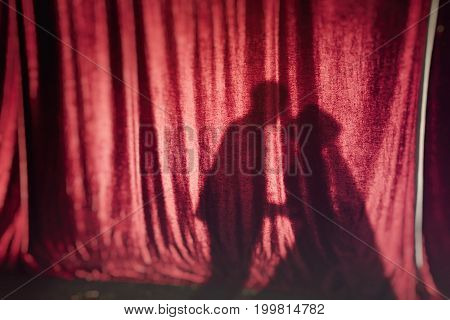 Shadows From The Kissing Couple On Red Fabric