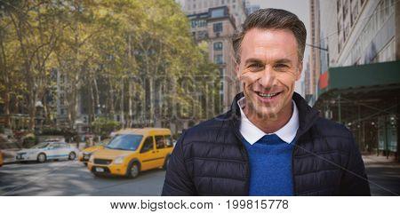 Portrait of handsome mature man  against new york street