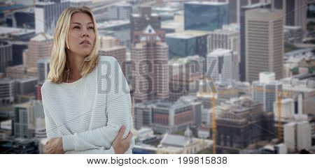 Portrait of beautiful blonde women  against towers and building in city