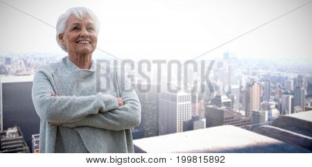 Portrait of retired women  against high angle view of city