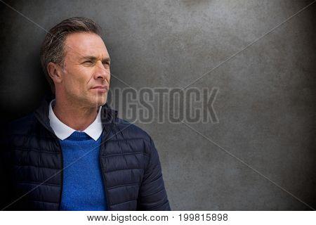 Portrait of handsome man against close-up of blackboard