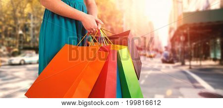 Women holding shopping bag  against new york street
