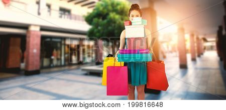 Composite image of women holding shopping bag