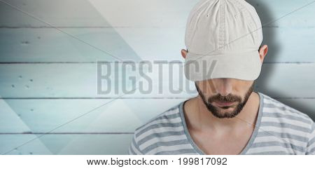 Handsome man wearing hat  against colored wood