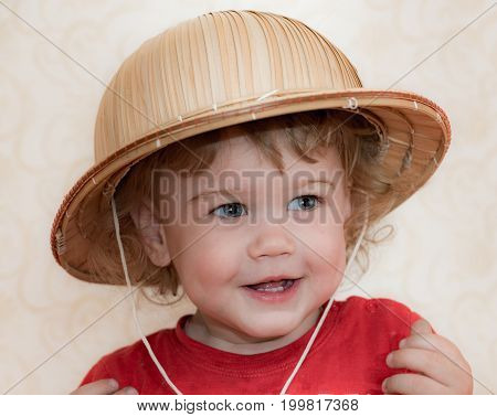 Blond Curly-haired Child Straw Hat
