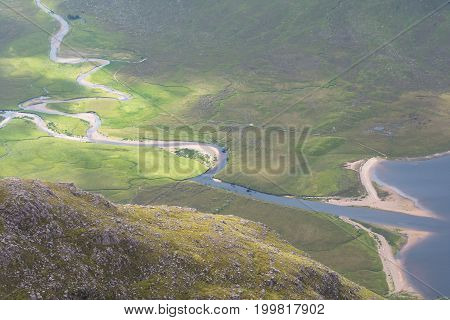 Two Rivers Meeting At Bottom Mountain Valley In Scottish Highlands