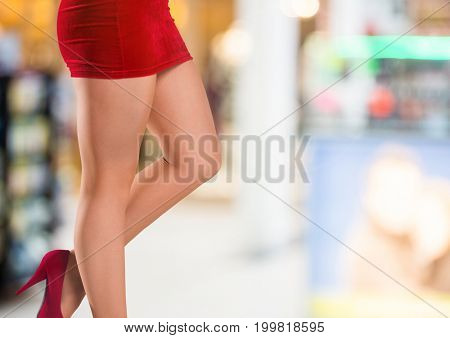 Digital composite of Sexy woman's legs in skirt and high heels in front of colors