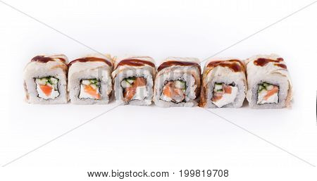 Healthy japanese restaurant food delivery. Set of salmon and eel rolls with soft cheese and unagi sauce isolated on white background, closeup.