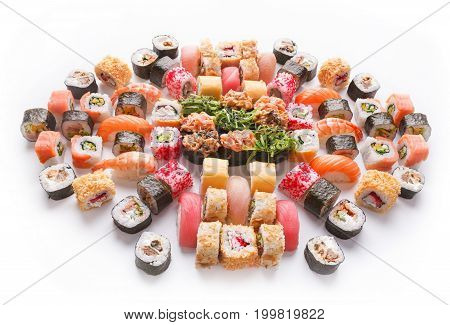 Japanese food restaurant delivery - tuna sushi maki, salmon rolls and spicy gunkans with seaweed big party platter set isolated on white background