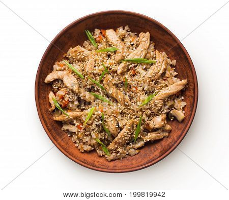 Asian food bowl isolated at white background. Teriyaki beef with rice, mushrooms, sesame and lemon grass. Japanese restaurant food delivery, top view