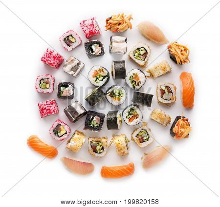 Big party sushi set isolated on white background. Japanese food delivery and take away. Fish and vegetable rolls, salmon and seabass nigiri, spicy gunkans, top view