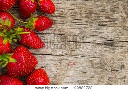 Ripe Fresh Strawberries On Rustic Wooden Background With Copy Space. Top View
