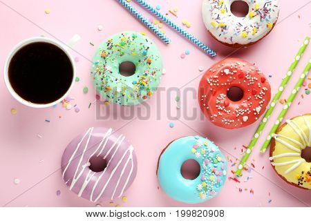 Tasty Donuts With Sprinkles With Cup Of Coffee On Pink Paper Background