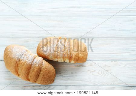 Fresh croissants on the white wooden table