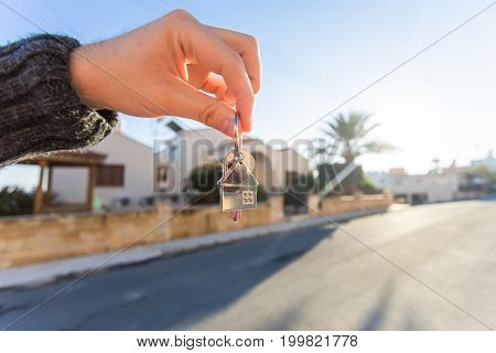 Key in hand for new home and real estate. Concept of housewarming, tenant and new house