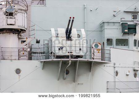 LONDON, ENGLAND - JUNE 08, 2017:  Anti aircraft guns at HMS Belfast battleship moored on the River Thames. London the UK