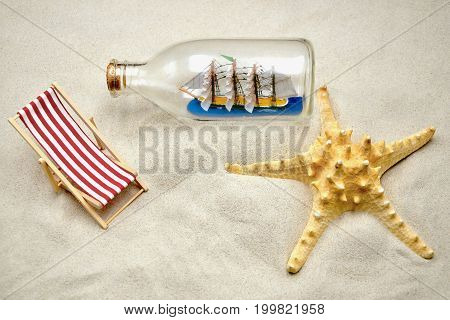 deck chair with starfish and a boat in a bottle
